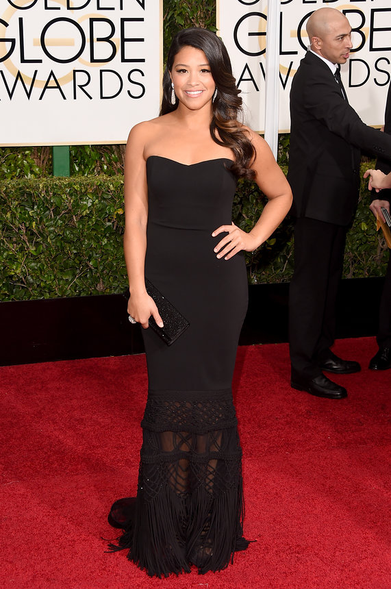 Gina Rodriguez in , Chopard jewellry and a Judith Leiber bag