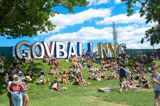 Concertgoers relax at The Governors Ball Music Festival at Randall's Island Park on Friday, June 6