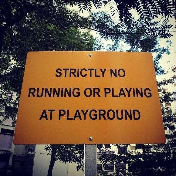 A sign in a Singapore playground