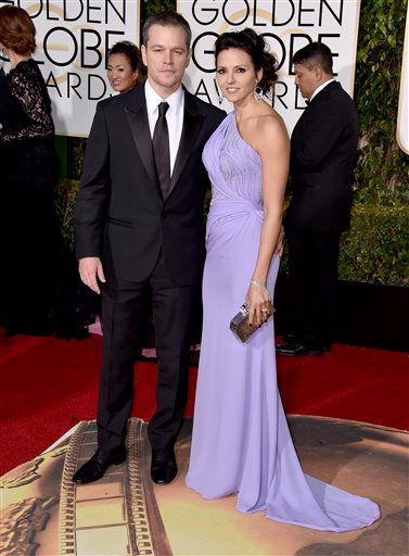 Matt Damon, left, and Luciana Barroso arrive at the 73rd annual Golden Globe Awards on Sunday, Jan. 10, 2016, at the Beverly Hilton Hotel in Beverly Hills, Calif. (Photo by Jordan Strauss/Invision/AP)