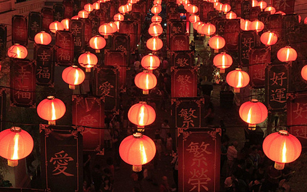 People walk under a Chinese Lantern display during a Chinese New Year eve celebration at Chinatown in Manila